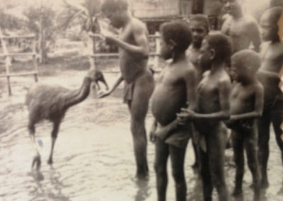 Berik children with baby cassowary