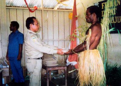 Bular receiving his New Testament