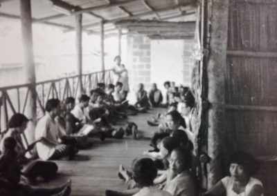 Gospel meeting on clinic porch at Mile 86