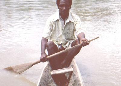 Kori paddling his canoe to come to class