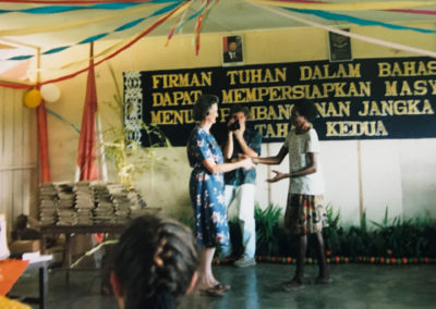 Magdalena receiving her New Testament from Sue