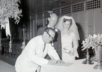 Mr. Liew signs Marriage Certificate