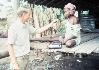Peter recording a Berik lady's story