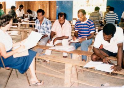 Sue and Berik tutors reading through the New Testament outloud