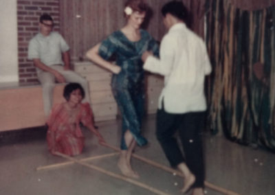 Sue dancing the Tinikling for Rehab 5 patients and staff