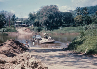 Vehicles on ferry crossing river